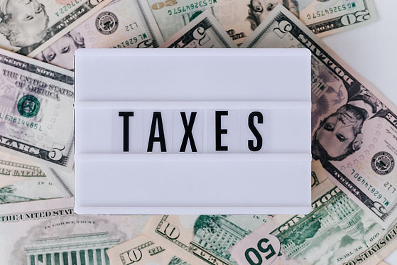 retro lightbox with the word taxes