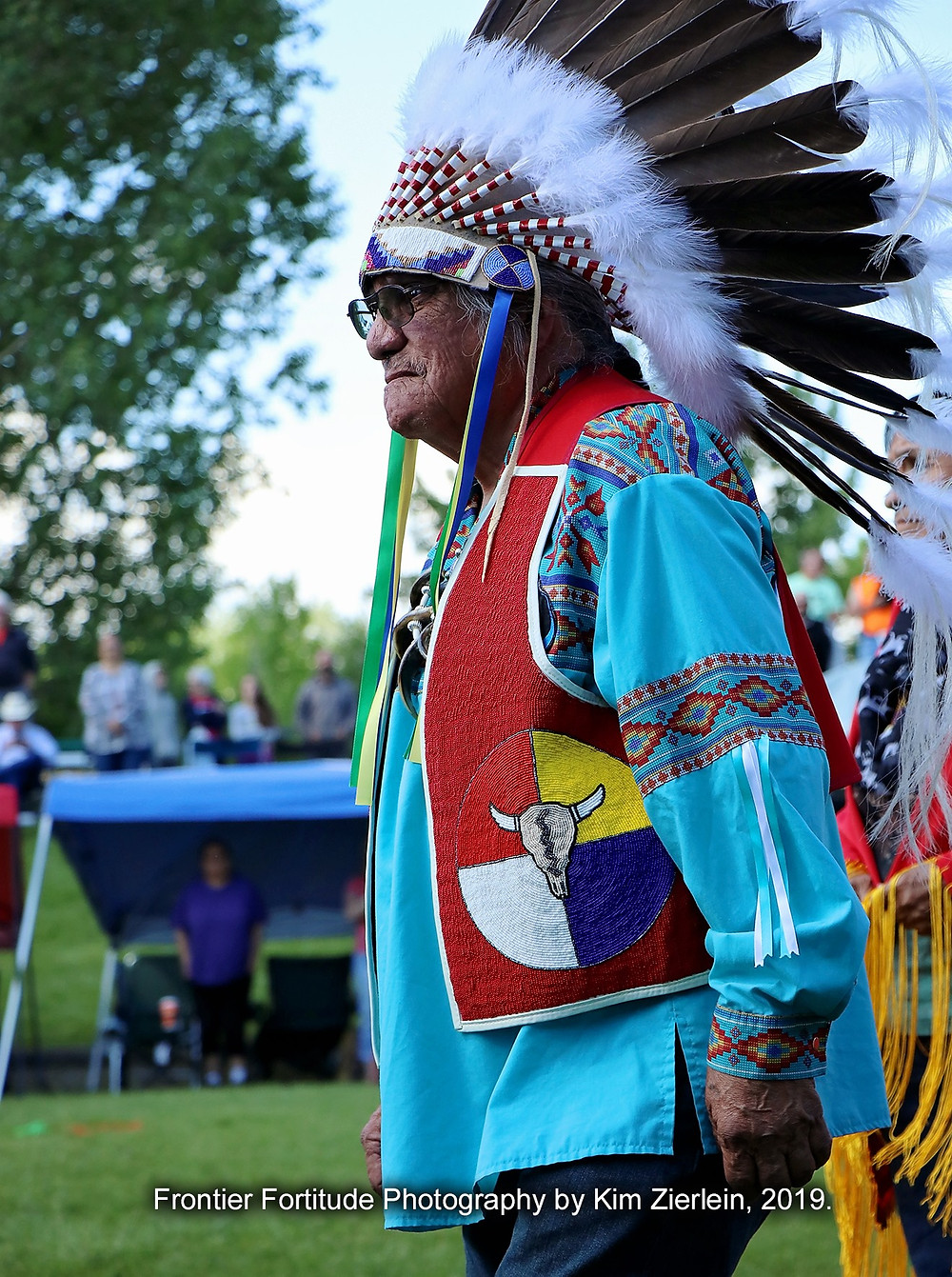 Elmer BlackBird, veteran honored both days with warbonnet gifting from Chico HerManyHorses