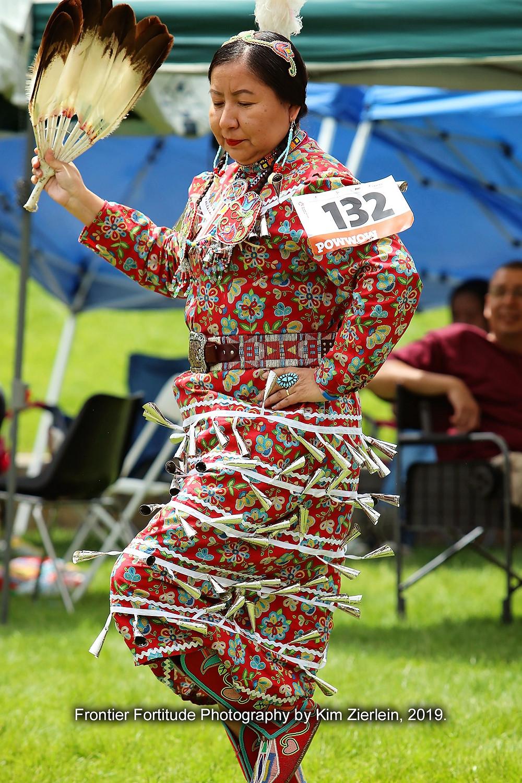 Della Big-Hair Stump in women's jingle dress division also native fashion designer of Designs by Della