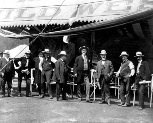 William F. Cody, James A. Bailey and other men at the entrance to the wild west show, ca. 1900. MS006 William F. Cody Collection. P.69.0986