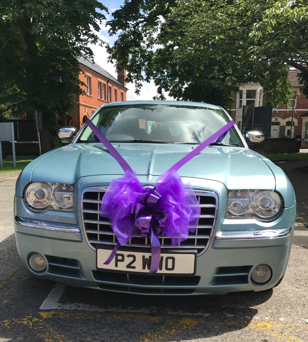 Chrysler decorated with cadburys purple ribbon_edited
