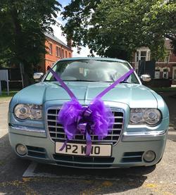 Chrysler decorated with cadburys purple ribbon_edited