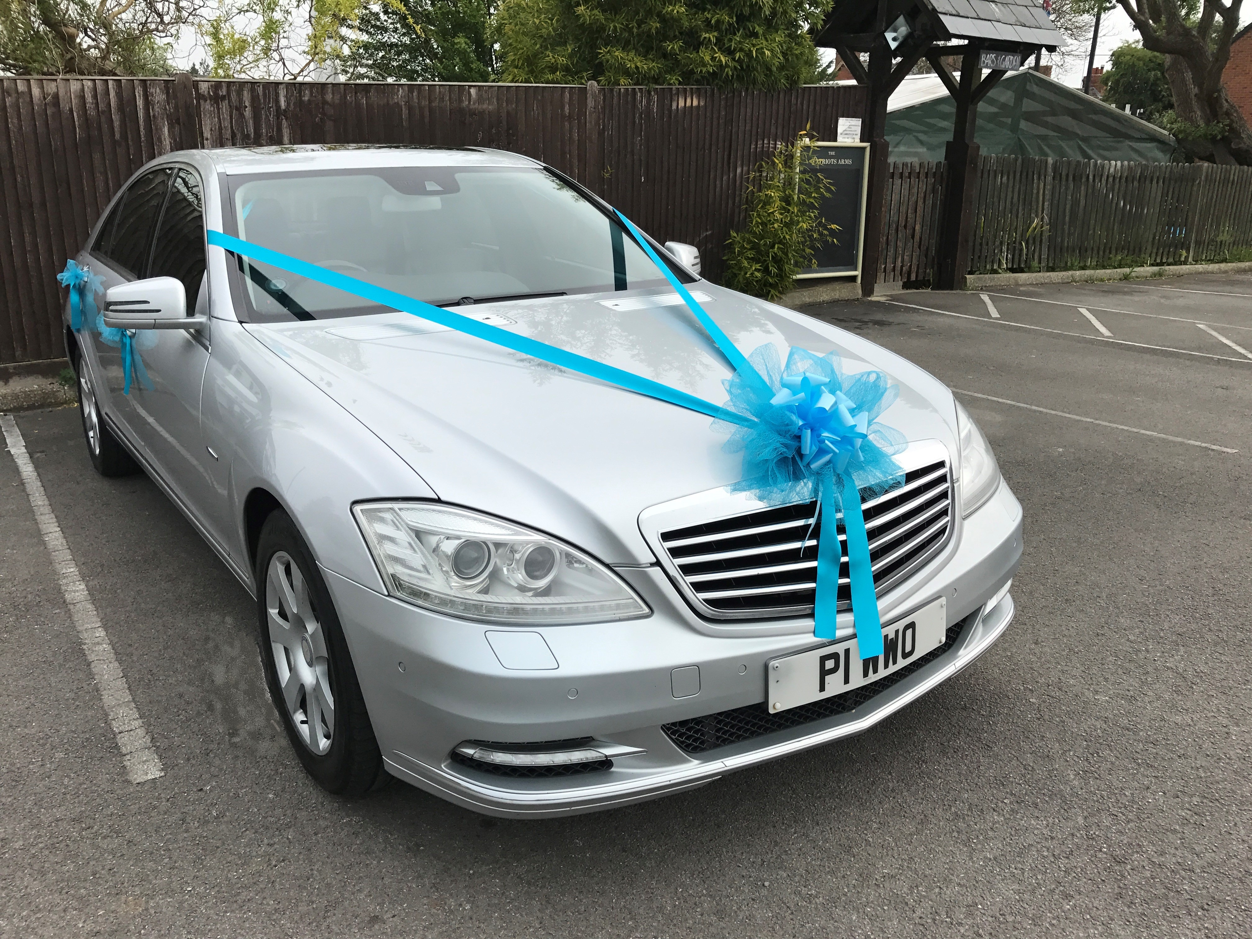 Wedding car with Peacock Blue ribbon