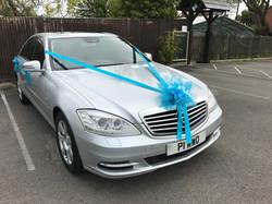 Wedding car with Peacock Blue ribbon