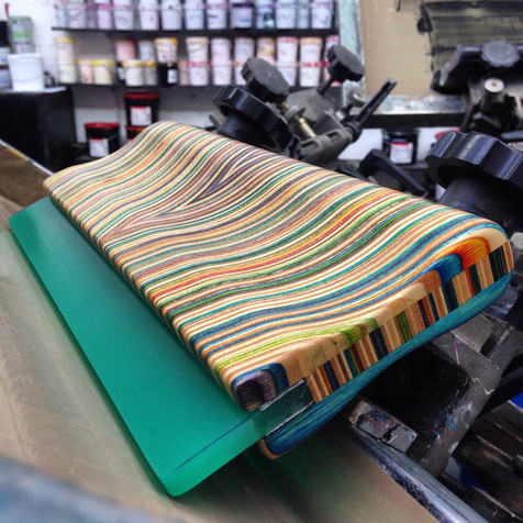 Squeegee made from recycled skateboards