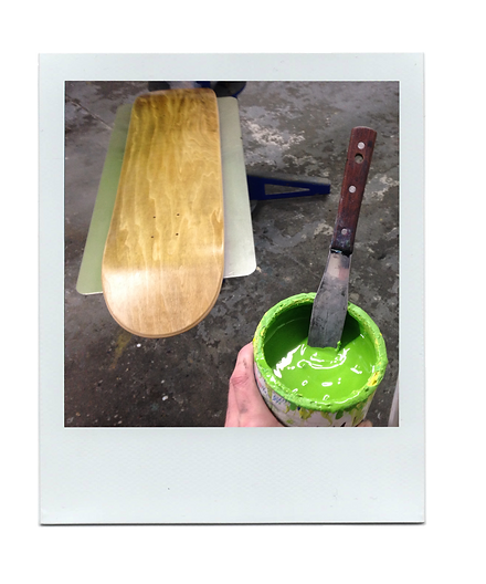 Setting up the screen printing of a skateboard on our newly made screen printing jig.
