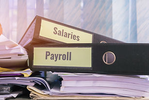 Payroll and salaries folders stack with