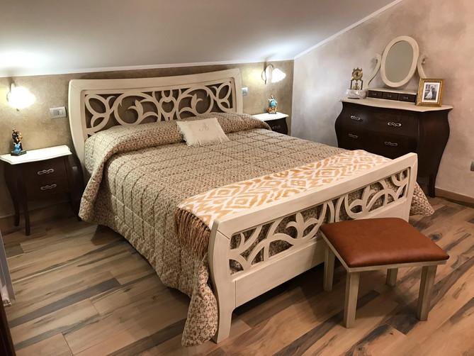 Camera da letto letto traforato.jpg