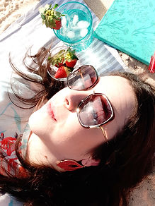 JaimeDill_author lying in sun