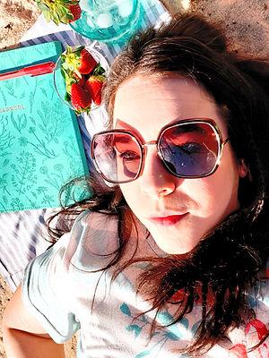 JaimeDill_author headshot in the sand
