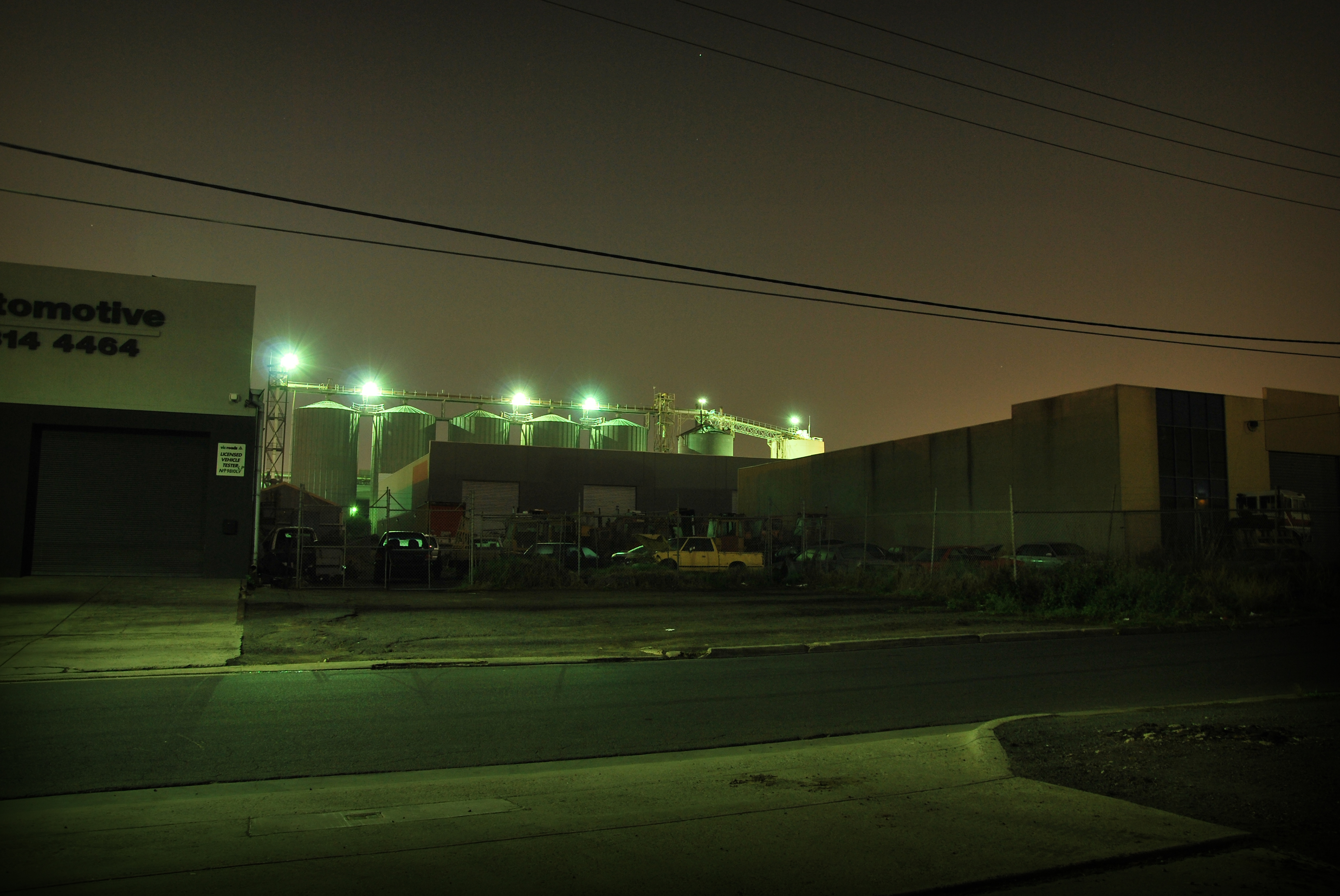 Car Yard in Front of Silos
