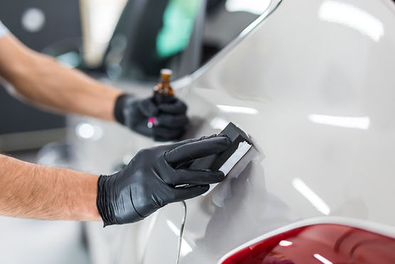 Car detailing - Man applies nano protect
