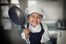 Portrait of a funny four years girl cook
