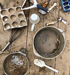 Children's outdoor mud kitchen at a pres