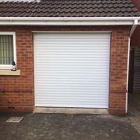 white garage door by Leo Security Solutions