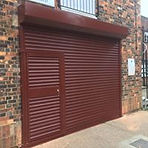 Commercial shutters with access door