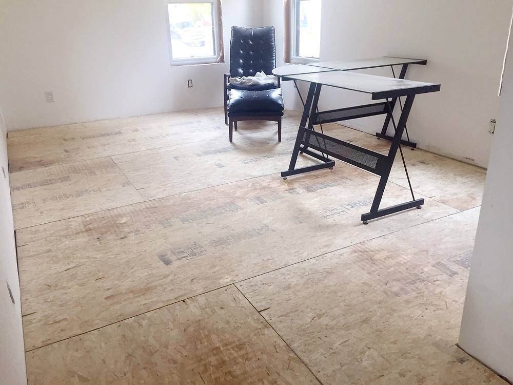 Finished office subfloor in DIY home renovation