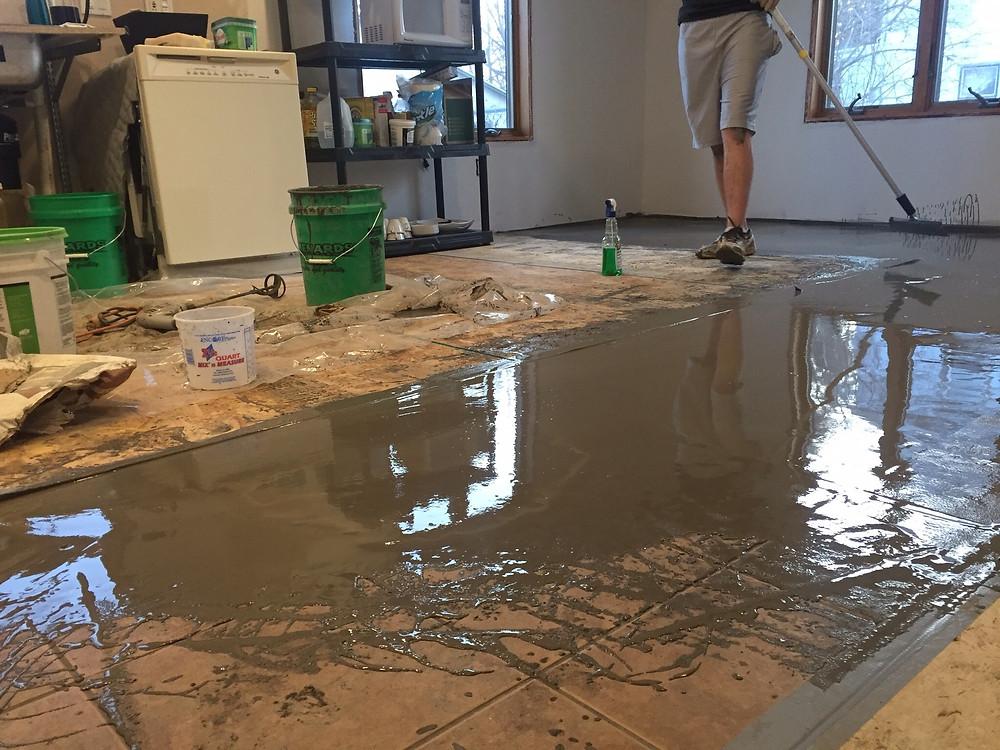 Self-leveling cement floor in DIY home renovation