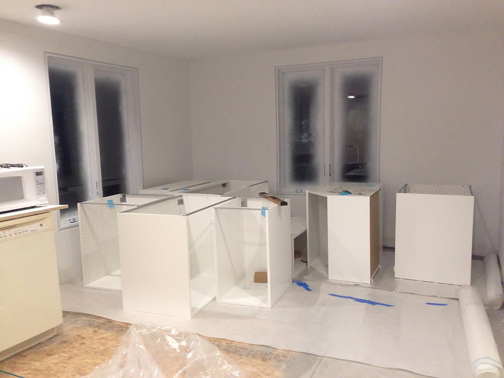 Assembling IKEA kitchen cabinets for DIY home renovation