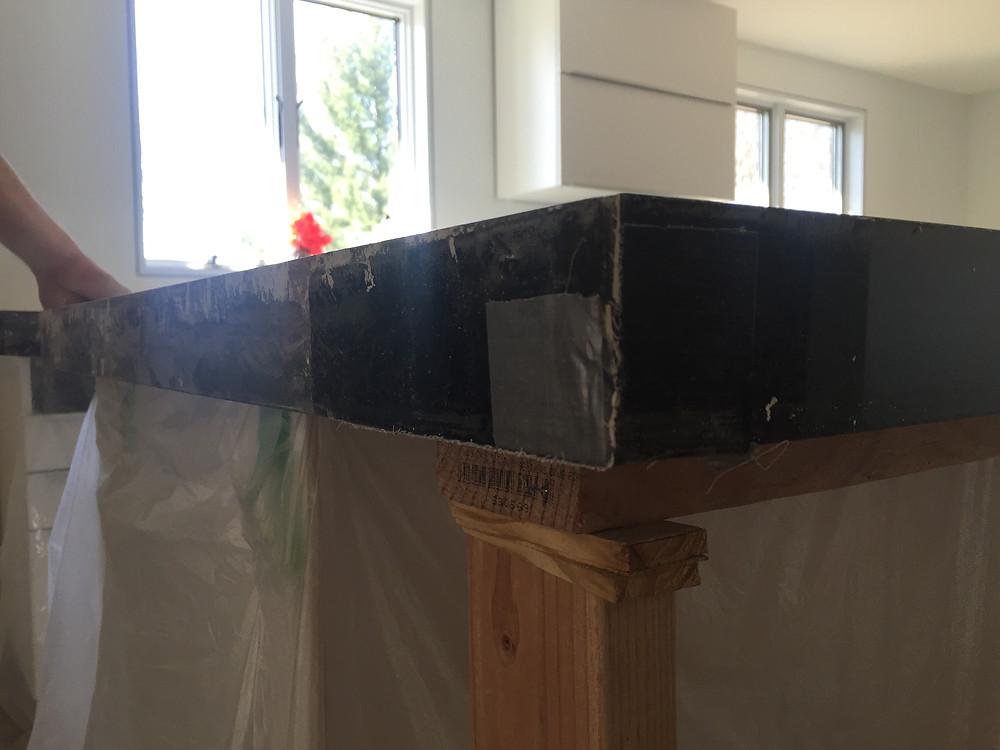 Square edge profile during install of concrete countertops
