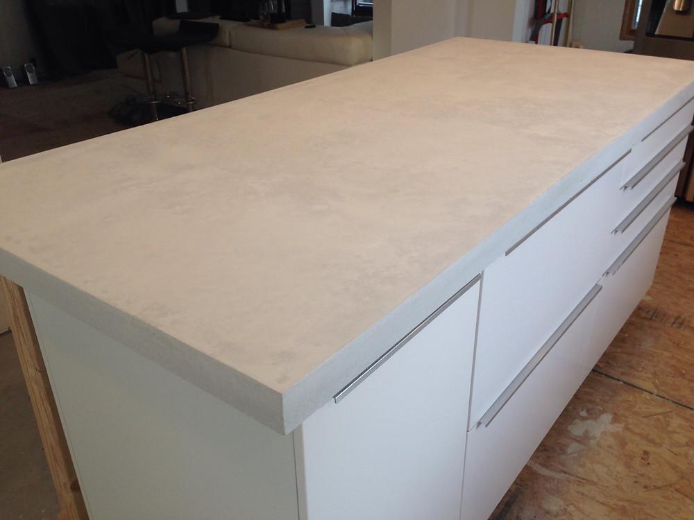 Concrete countertops installation on kitchen island complete