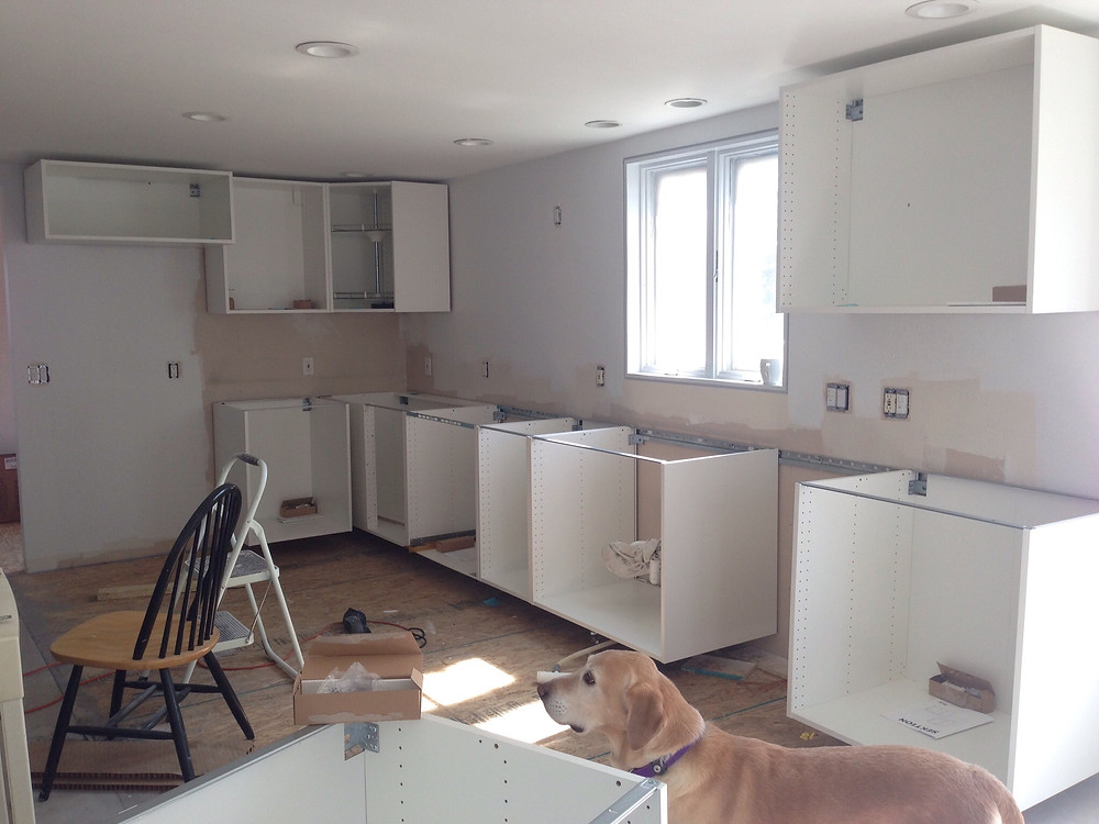 IKEA kitchen being installed in DIY home renovation
