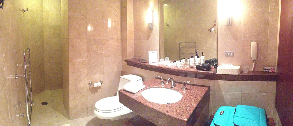 Private full bathroom in airline club lounge
