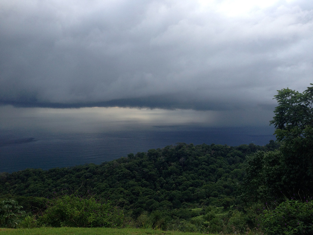 Watching a storm pass over the ocean from our villa