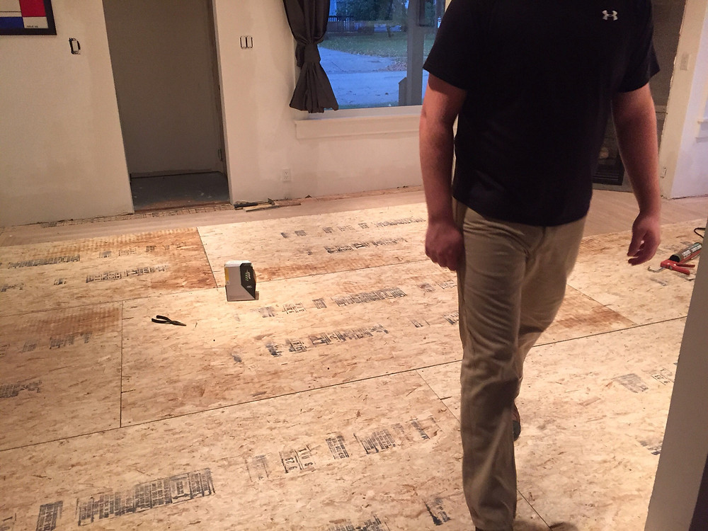 Finished living room subfloor in DIY home renovation