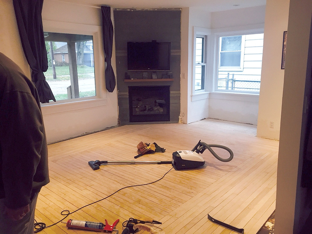 Living room prepped for subfloor in DIY home renovation