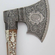 This small ornate ax was made in Germany during the late 1500s.