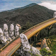 The Cau Vang, outside the city of Da Nang in Vietnam is held up by two giant stone hands.
