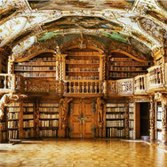 The library inside of the Waldsassen Abbey in Bavaria holds thousands of volumes bound in white pigskin.