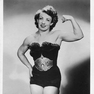 Mildred Burke, a pioneer of women's pro-wrestling who began wrestling men at carnivals in 1935. She would go on to wrestle over 200 men, losing to only 1.