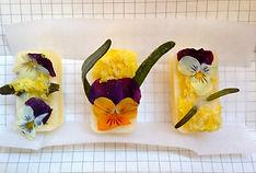 pansies, lemon zest & herbs in olive oil