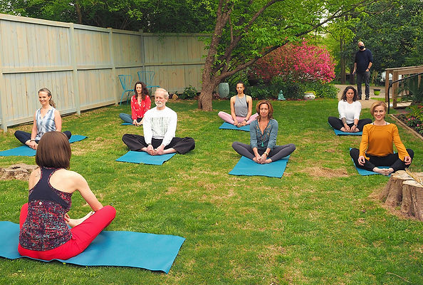 Outdoors Yoga Garden Instructors in pose