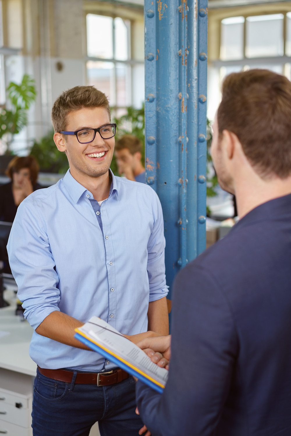 Teenage male student at interview in an apprenticeship shaking hands with employer: The Parents' Guide to