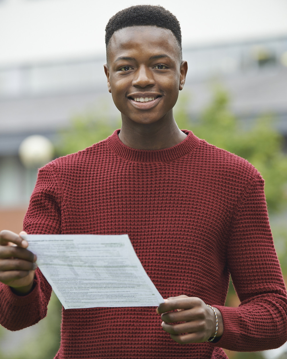 Male students receiving A level results on Results day 2021