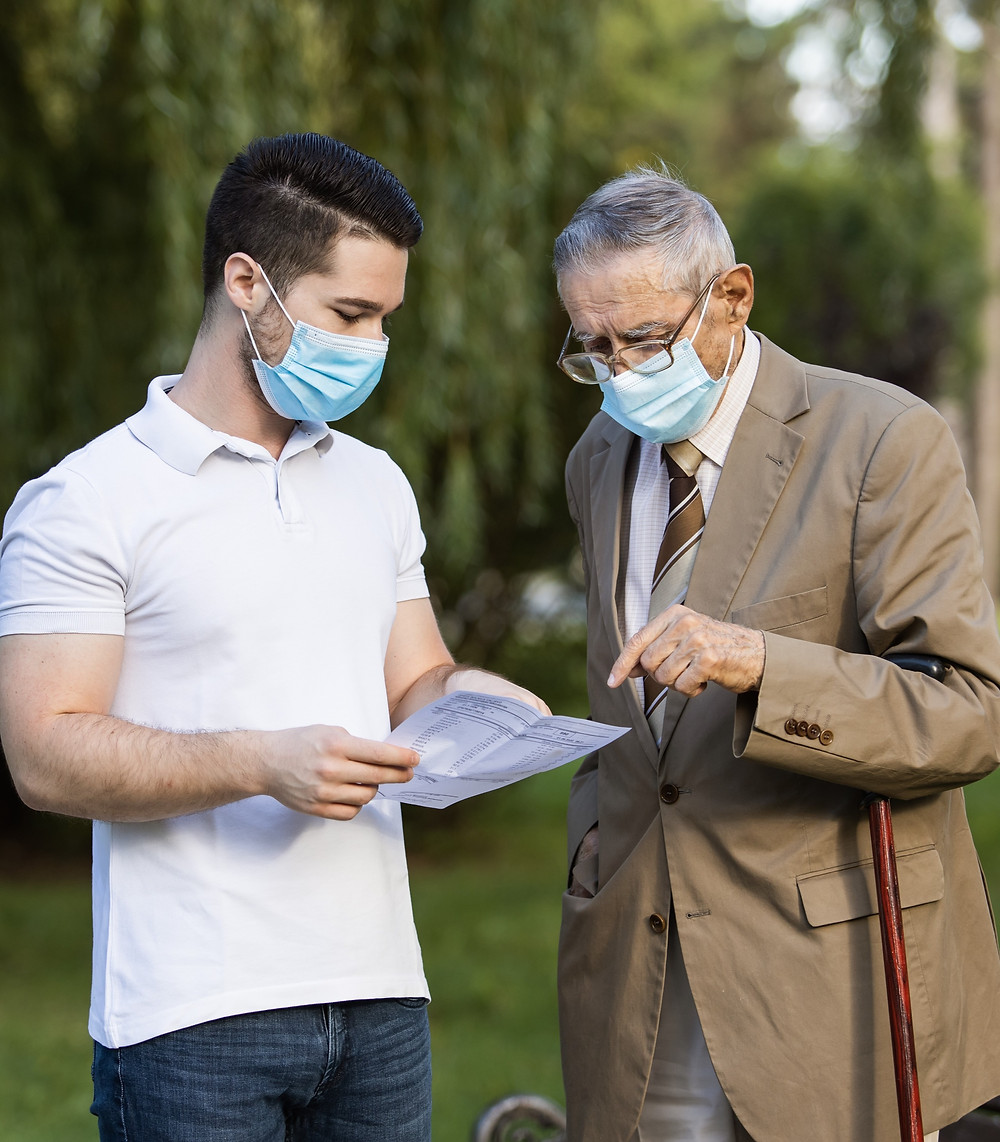 Grandfather and son speaking with face masks: The Parents' Guide to