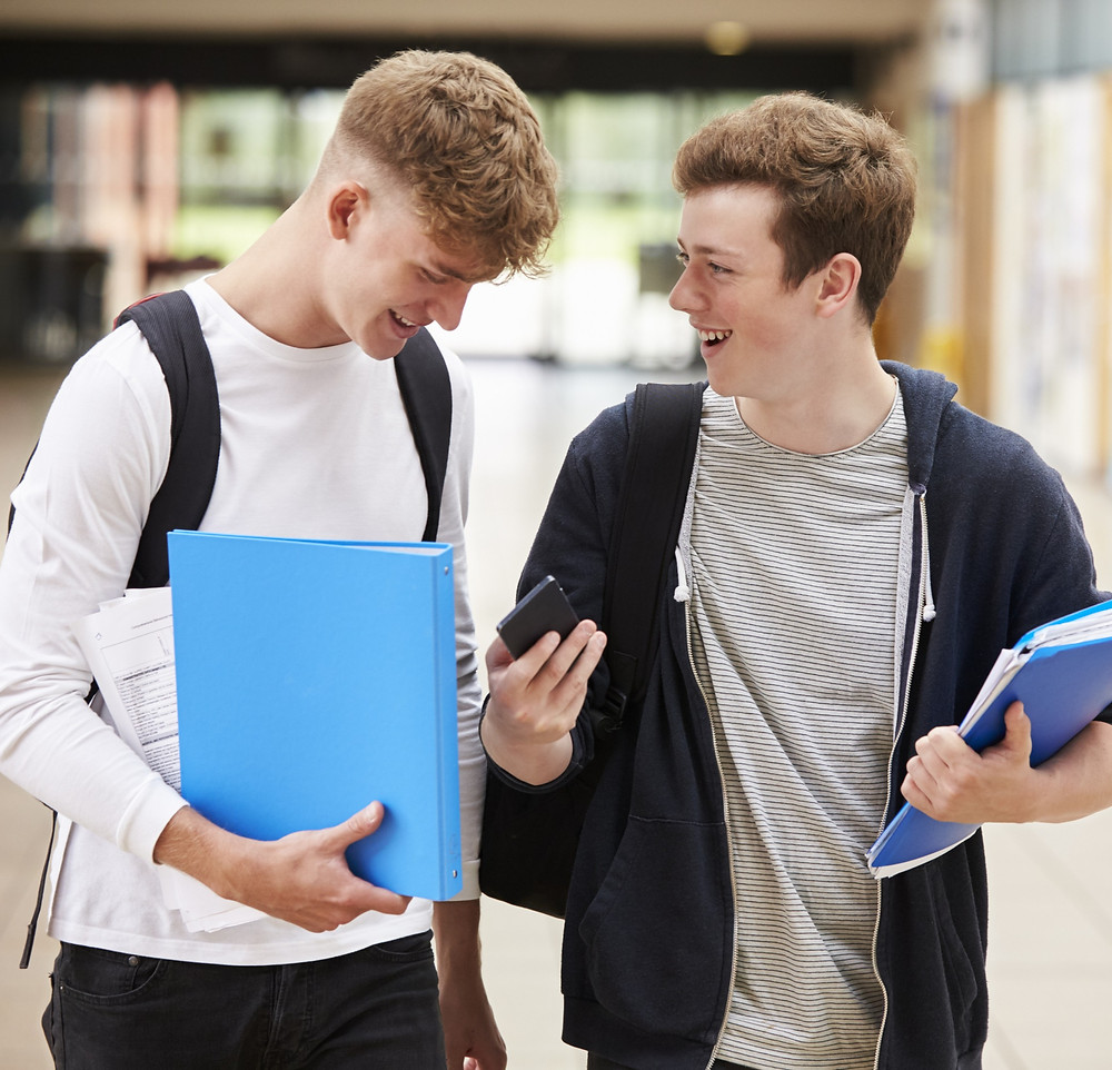 Two teenage boys in school going to collect GCSE results: The Parents' Guide to