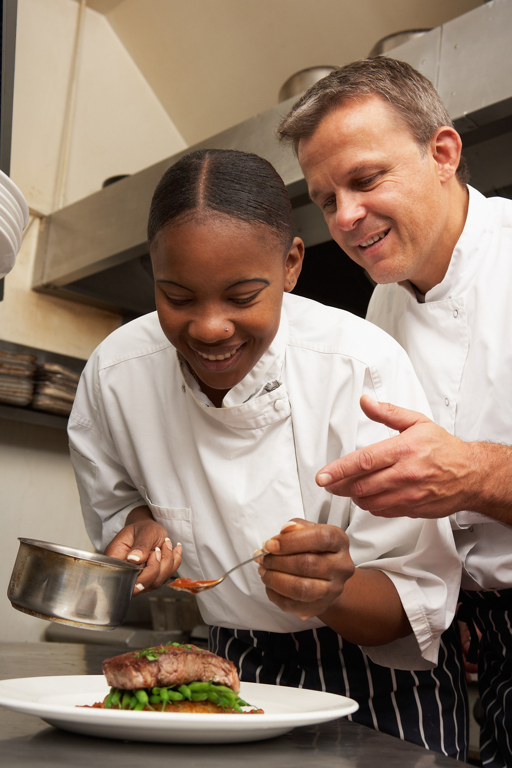 Female chef apprentice, supported by emplyer