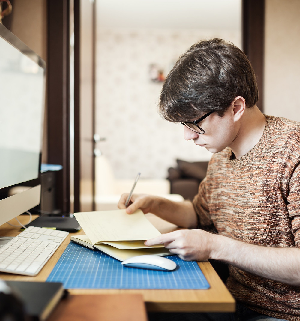 teenag boy checking diary in bedroom as part of virtual work experience: The Parents' Guide to