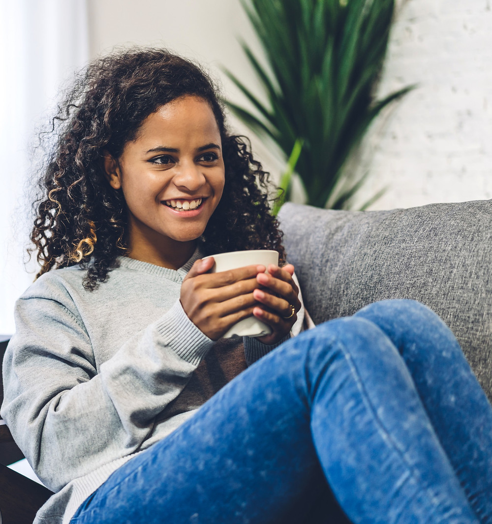 Teenage girl drinking coffee on sofa: The Parents' Guide to