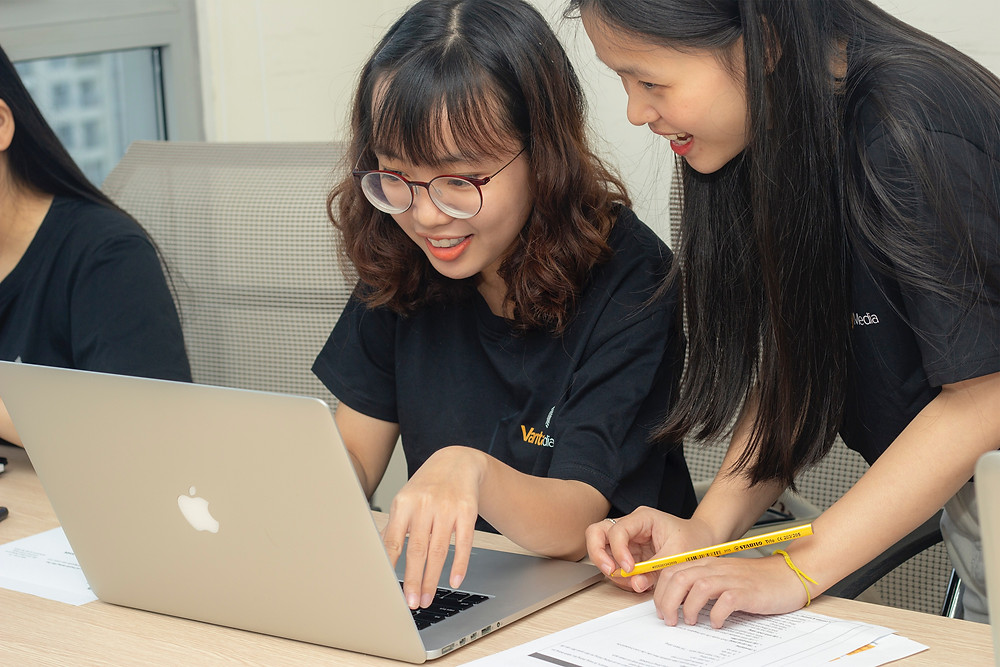 Two female students looking on the internet researching apprenticeship options: The Parents' Guide to