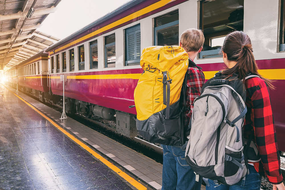 Two teenagers on gap year backpacking train station The Parents' Guide to