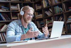 Happy male student online teacher wear h