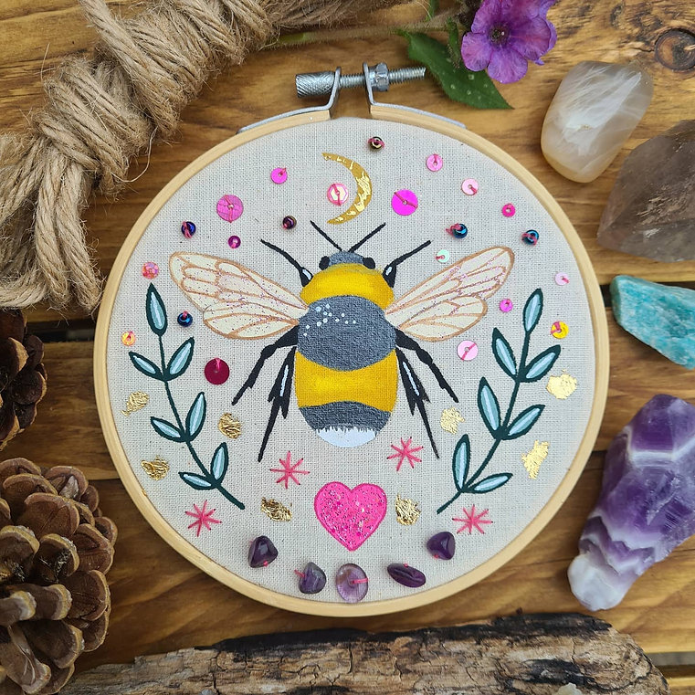 Embroidery hoop painting of a cute bumblebee in the light of the moon!