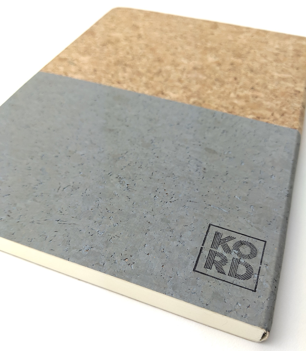cork notebook with grey print and KORD logo