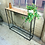 Black steel framed console table lifestyle shot