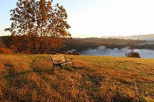 Photo of hilltop bench for contemplating the 360 degree views at Well Being Retreat Center